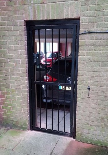 Barred gates with code locks fitted by AJK LOCKS